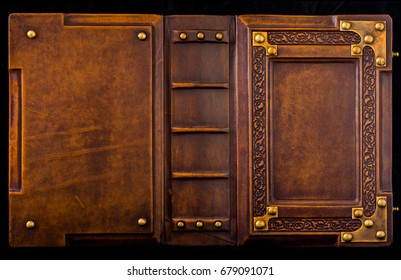 Aged brown leather bound medieval book cover with the brass corners and embossed frame captured in extra high resolution