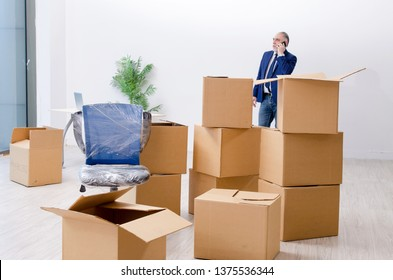 Aged businessman moving to new workplace
