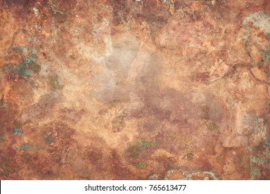 Aged copper plate texture with green patina stains. Old worn metal background.
