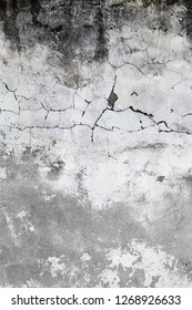 Aged cracked concrete stone plaster wall background and texture style. Wall covered with gray cement surface with cracks. Old grunge textures backgrounds. Plaster wall