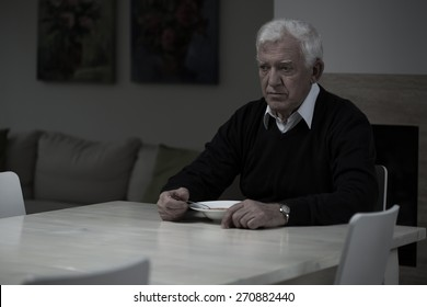 Aged depressed man and his lonely dinner