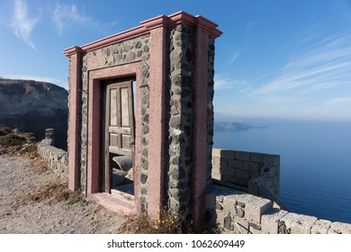 Aged door with view of the Mediterranean Sea on Santorini Island