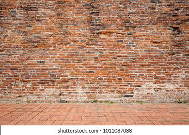 Aged empty red bricks wall and floor for background.