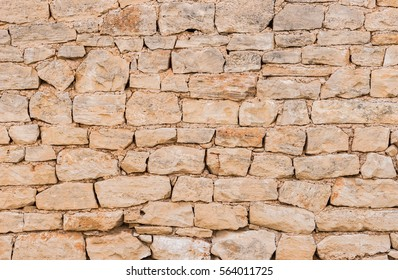 Aged grey stone wall texture.
