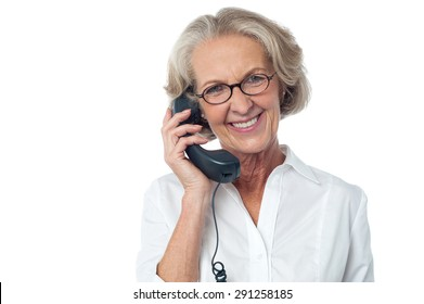 Aged happy woman answering a phone call