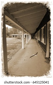 Aged image of an abandoned motel. Weathered and distressed framing. Sepia tone.