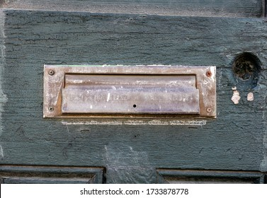 Aged Mail Slot on Old Painted Door