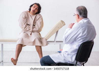 Aged male doctor psychiatrist examining young patient