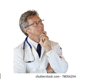 Aged medical doctor with hand on chin looks contemplative up. Isolated on white background.