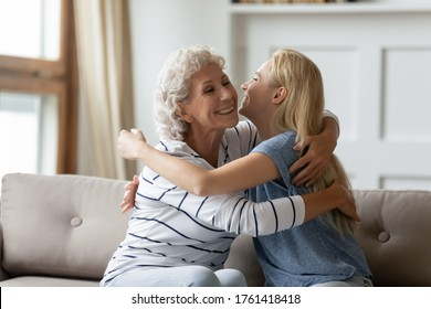 Aged mother and grown up adult daughter embracing seated on couch. Miss each other, not forget visit elderly parents, showing care express attention, caring offspring and older generation love concept - Shutterstock ID 1761418418