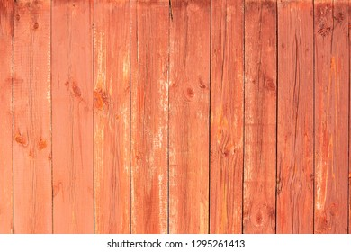 Aged Natural Old Red Color Obsolete Wooden Board Background. Grungy Vintage Wooden Surface. Painted Obsolete Weathered Texture Of Fence.