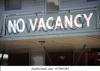 aged neon no vacancy sign