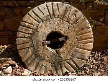 Aged old mill millwheel stone wheel in Cuenca Spain