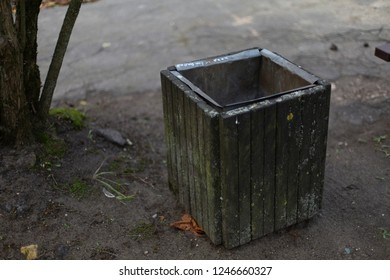 Aged outdoor wooden grey trash waste bin
