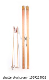 aged pair of wooden ski and poles on white background