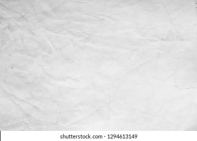 Aged paper sheet. Blank old background with dust and dirty stains. Vintage and antique art concept. Detailed closeup studio shot. Front view. Toned