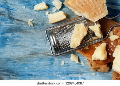 Aged parmesan cheese on a wooden table top view