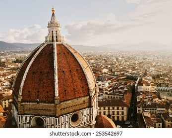 Aged photo of Italy Florence (Firenze) Duomo Santa Maria del Fiore on morning sun and haze from aeral view from campanile retro vintage style