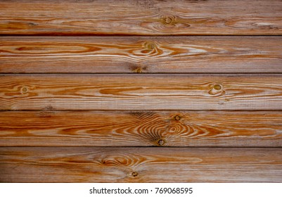 Aged pine wood plank texture with knots. Abstract grunge background.