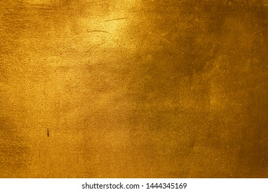 Aged rough gold texture use as social media or vintage style wall paper background idea