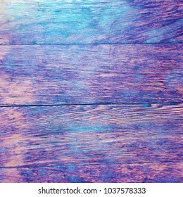 Aged rustic vintage colorful wooden background in purple and teal colors