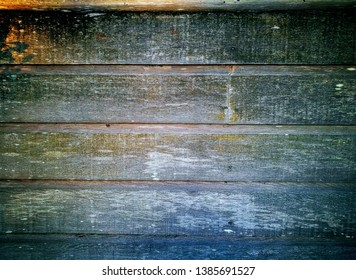 aged timber weatherboard wall at sunset