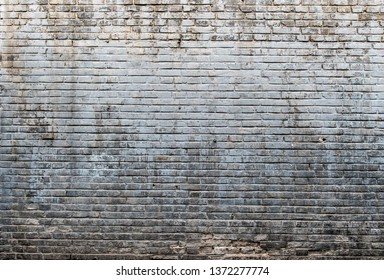 Aged and weathered brick wall background