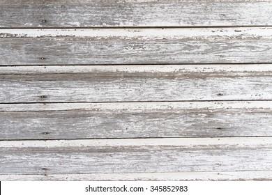 Aged whitewashed wood siding.