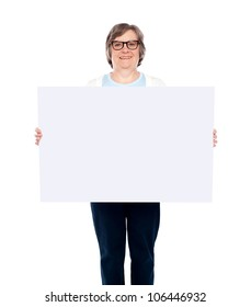 Aged woman displaying blank poster against white background