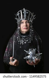 Aged woman represents a metallic queen on black background
