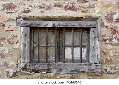 Aged wooden window in masonry stone walls house in Navarra Pyrenees Spain