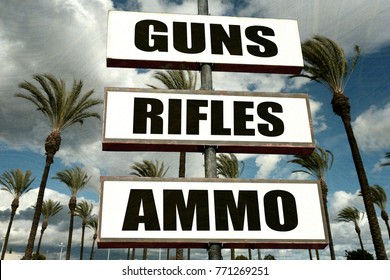 aged and worn guns store sign with palm trees
