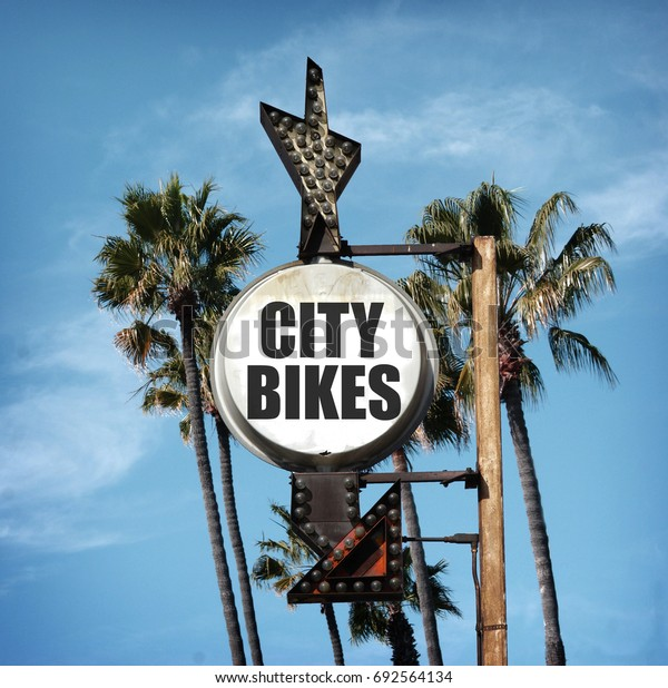 aged and worn photo of city bikes sign