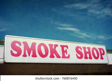 aged and worn photo of smoke shop sign