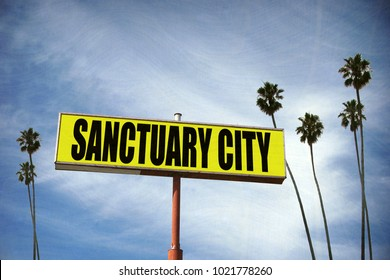 aged and worn sanctuary city sign