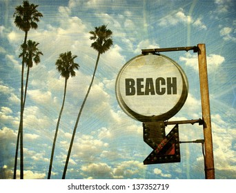 aged and worn vintage beach sign with palm trees