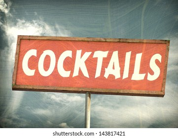 aged and worn vintage cocktail sign