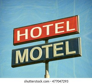aged and worn vintage hotel motel sign