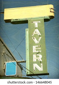 aged and worn vintage neon tavern sign