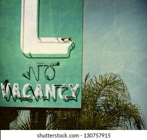 aged and worn vintage no vacancy sign