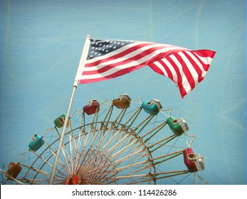 aged and worn vintage photo of american flag and ferris wheel ride