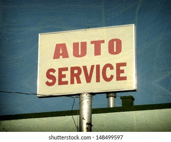 aged and worn vintage photo of auto service sign