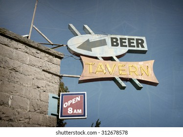 aged and worn vintage photo of beer tavern neon sign