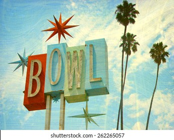 aged and worn vintage photo of  bowling sing with palm trees