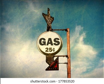aged and worn vintage photo of cheap gas sign