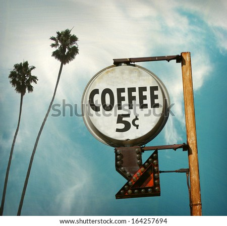 aged and worn vintage photo of coffee five cents sign