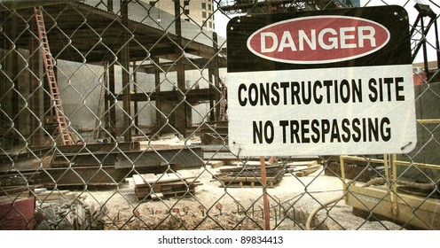 aged and worn vintage photo of danger construction site sign