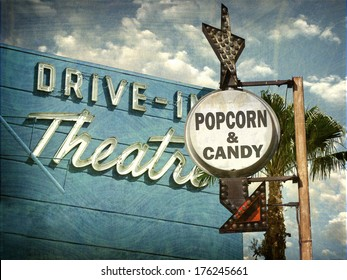 aged and worn vintage photo of drive in movies sign with popcorn and candy advertisement