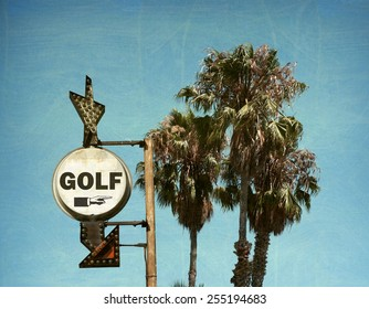 aged and worn vintage photo of golf sign and palm trees