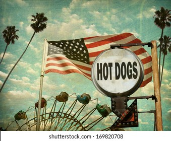 aged and worn vintage photo of hot dogs sign at amusement park with ferris wheel
